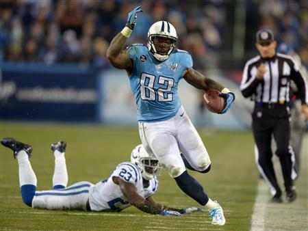 Nov 14, 2013; Nashville, TN, USA; Tennessee Titans tight end Delanie Walker (82) is pursued by Indianapolis Colts cornerback Vontae Davis (23) at LP Field. The Colts defeated the Titans 30-27. Mandatory Credit: Kirby Lee-USA TODAY Sports