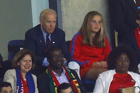 U.S. Vice President Joe Biden (top L) and his granddaughter Naomi watch their 2014 World Cup Group G soccer match against Ghana at the Dunas arena in Natal June 16, 2014. REUTERS/Brian Snyder