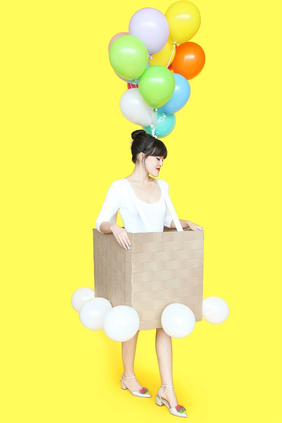 """<p>How creative is this? Your tween can fly up, up, and away with this adorable hot air balloon costume, made from strips of chipboard. </p><p><strong>Get the tutorial at</strong> <strong><a href=""""http://www.awwsam.com/2015/09/diy-hot-air-balloon-halloween-costume.html"""" rel=""""nofollow noopener"""" target=""""_blank"""" data-ylk=""""slk:Aww Sam"""" class=""""link rapid-noclick-resp"""">Aww Sam</a>. </strong></p><p><a class=""""link rapid-noclick-resp"""" href=""""https://www.amazon.com/Chipboard-Sheets-inch-Scrapbooking-MagicWater/dp/B07BY971FK/ref=redir_mobile_desktop?ie=UTF8&aaxitk=ZZ0eGu.yUxRpax3al2tj6w&hsa_cr_id=6686318920201&ref_=sbx_be_s_sparkle_mcd_asin_0&tag=syn-yahoo-20&ascsubtag=%5Bartid%7C10050.g.21603260%5Bsrc%7Cyahoo-us"""" rel=""""nofollow noopener"""" target=""""_blank"""" data-ylk=""""slk:SHOP CHIPBOARD"""">SHOP CHIPBOARD</a></p>"""
