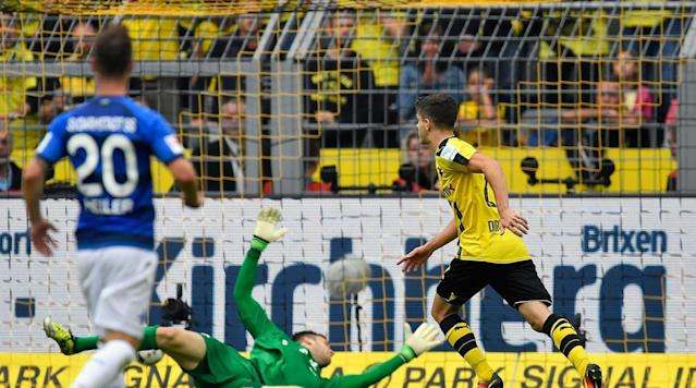 <p>Christian Pulisic of Borussia Dortmund scores during the Bundesliga match against SV Darmstadt 98 at Signal Iduna Park on Sept. 17, 2016 in Dortmund, Germany.</p>