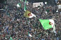 Anti-government protesters flooded the streets of Algiers on Friday in numbers resembling those of rallies at the peak of the movement that started in February