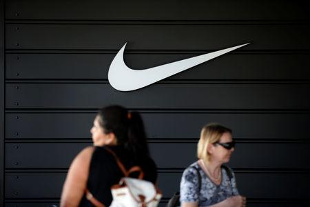 FILE PHOTO: The logo of Dow Jones Industrial Average stock market index listed company Nike (NKE) is seen in Los Angeles, California, United States, April 12, 2016. REUTERS/Lucy Nicholson/File Photo