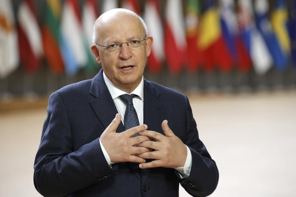 Portugal's Foreign Minister Augusto Santos Silva speaks with the media as he arrives for a meeting of EU foreign ministers at the European Council building in Brussels, Monday, May 10, 2021. EU Foreign Affairs Ministers meet in Brussels to discuss current affairs, tensions with Russia, the Western Balkans, transatlantic relations and Belarus. (AP Photo/Olivier Matthys, Pool)