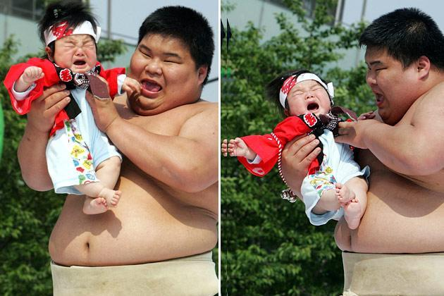 TOKYO - APRIL 28: Sumo wrestling students hold babies as they try to make them cry during the Crying Sumo competition at Sensoji Temple on April 28, 2007 in Tokyo, Japan. The first baby to cry wins the competition. The ceremony takes place in Japan to wish for the good health of the child as it is said that crying is good for the health of babies. (Photo by Junko Kimura/Getty Images)
