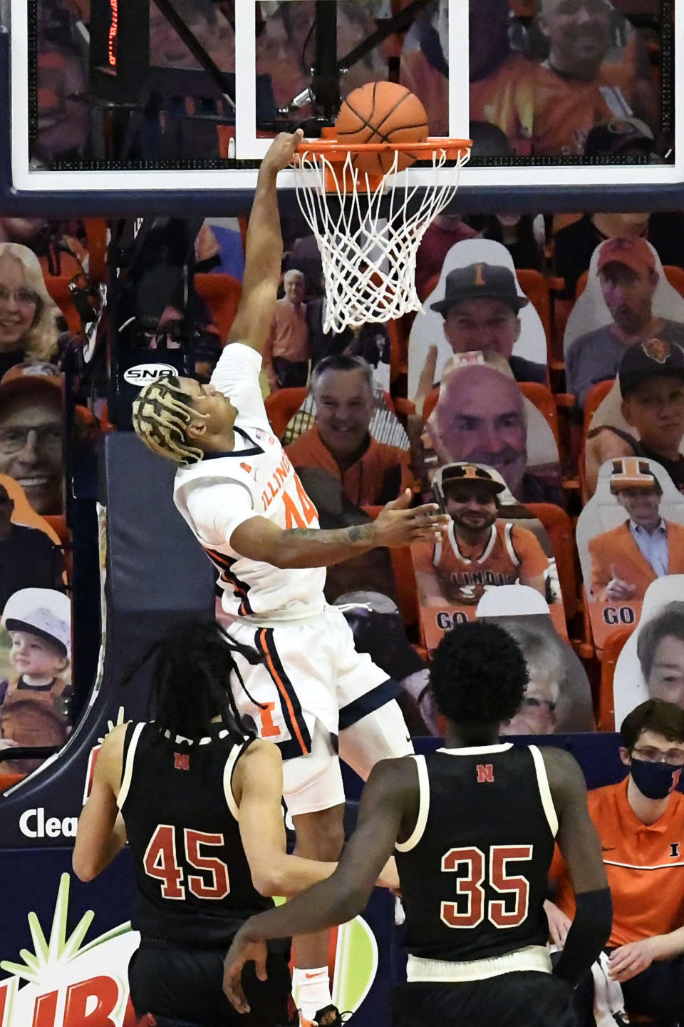 Illinois guard Adam Miller (44) scores as Nebraska guard Dalano Banton (45) and center Eduardo Andre (35) watch during the first half of an NCAA college basketball game Thursday, Feb. 25, 2021, in Champaign, Ill. (AP Photo/Holly Hart)