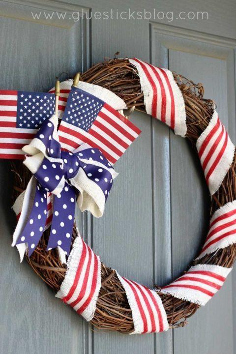 """<p>Before Independence Day arrives, we suggest taking a trip to your local dollar store to put together this inexpensive decoration. <br></p><p><strong>Get the tutorial at <a href=""""http://gluesticksblog.com/2016/05/old-glory-patriotic-wreath-tutorial.html"""" rel=""""nofollow noopener"""" target=""""_blank"""" data-ylk=""""slk:Gluesticks"""" class=""""link rapid-noclick-resp"""">Gluesticks</a>. </strong></p><p><strong><a class=""""link rapid-noclick-resp"""" href=""""https://www.amazon.com/Super-Tough-Stick-6-Inch-25-Pack/dp/B009URZ0KE/ref=sr_1_2?tag=syn-yahoo-20&ascsubtag=%5Bartid%7C10050.g.4464%5Bsrc%7Cyahoo-us"""" rel=""""nofollow noopener"""" target=""""_blank"""" data-ylk=""""slk:SHOP AMERICAN FLAGS"""">SHOP AMERICAN FLAGS </a></strong></p>"""