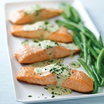"<p>What's one way to improve pesto? Make it creamy and slather it over grilled salmon!</p><p>Get the recipe from <a href=""https://www.delish.com/cooking/recipe-ideas/recipes/a21190/grilled-salmon-creamy-pesto-sauce-recipe-kft0313/"" rel=""nofollow noopener"" target=""_blank"" data-ylk=""slk:Delish"" class=""link rapid-noclick-resp"">Delish</a>.</p>"