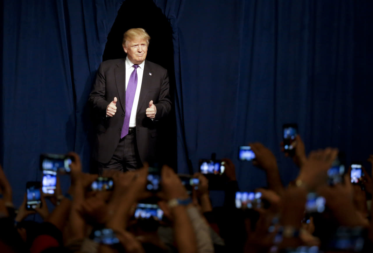 <p>Republican presidential candidate Donald Trump greets the applause at his caucus night rally Tuesday, Feb. 23, 2016, in Las Vegas.<i> (Photo: Jae C. Hong/AP)</i></p>