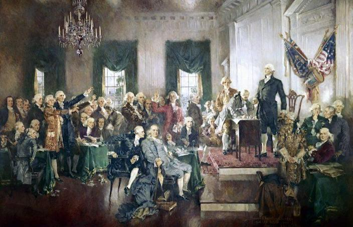 """""""Scene at the Signing of the Constitution of the United States,"""" with George Washington, Benjamin Franklin and Thomas Jefferson, at the Constitutional Convention of 1787; oil painting on canvas by Howard Chandler Christy, 1940. The painting is 20 by 30 feet and hangs in the United States Capitol building. (Photo: GraphicaArtis/Getty Images)"""