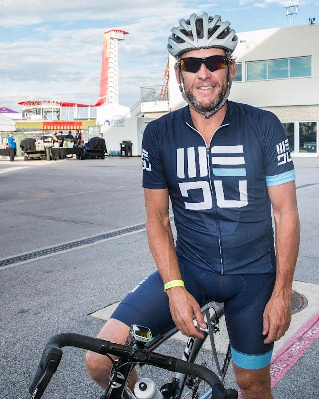 Lance Armstrong continues the ride and run (AFP Photo/SUZANNE CORDEIRO)