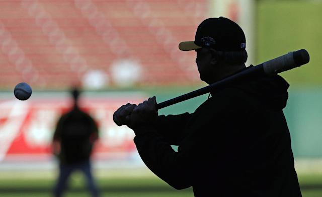 Pittsburgh Pirates manager Clint Hurdle hits infield practice before Game 5 of a National League baseball division series between the Pirates and the St. Louis Cardinals on Wednesday, Oct. 9, 2013, in St. Louis. (AP Photo/Charlie Riedel)
