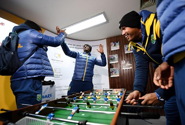 <p>Members of the Brazilian team react during a game of baby foot at the Olympic Village ahead of the PyeongChang 2018 Winter Olympic Games. (FRANCK FIFE/AFP/Getty Images) </p>