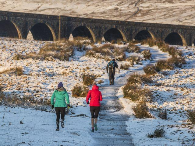 Runners at Ribblehead Viaduct in North Yorkshire (Danny Lawson/PA)