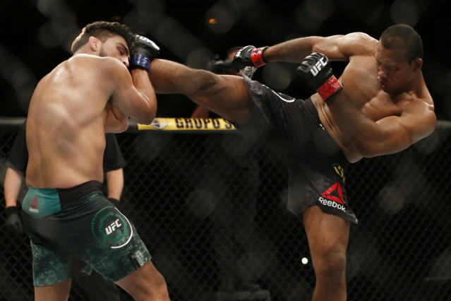 Ronaldo Souza, right, from Brazil, kicks Kelvin Gastelum, from the United States, during their UFC middleweight mixed martial arts bout in Rio de Janeiro, Brazil, early Sunday, May 13, 2018. (AP Photo/Leo Correa)