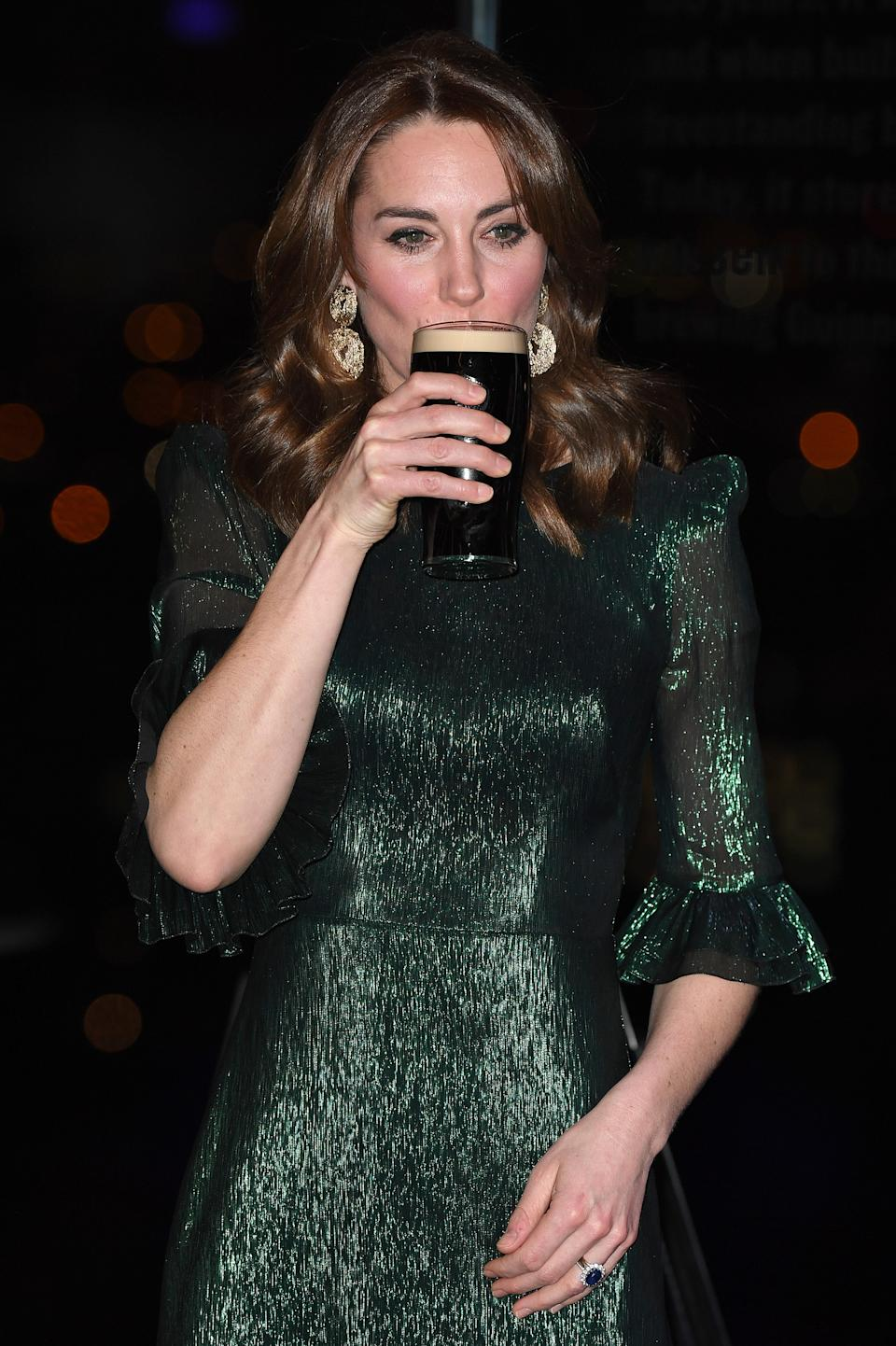 The Duchess of Cambridge drinks a Guinness at a reception hosted by the British Ambassador to Ireland. (Getty Images)