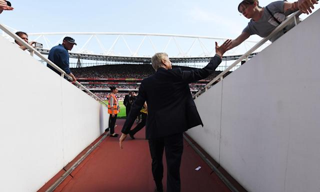 Arsene Wenger shakes a fan's hand before Arsenal's 4-1 win against West Ham.