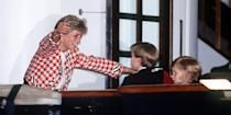 <p>Diana greets her sons on the deck of the yacht Britannia when they joined their parents on an official visit to Canada.</p>