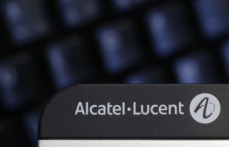 The logo of the telecom equipment maker Alcatel-Lucent is seen on a desk telephone in Paris