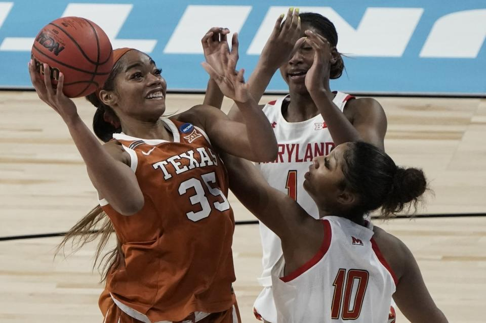 FILE - Texas's Charli Collier shoots over Maryland's Angel Reese during the second half of an NCAA college basketball game in the Sweet 16 round of the Women's NCAA tournament in San Antonio, in this Sunday, March 28, 2021, file photo. The Dallas Wings basically control the WNBA draft on Thursday night, April 15, 2021, with the top two picks and four first-round choices. The Wings could draft Texas' Charli Collier with one of the top picks.(AP Photo/Morry Gash, File)