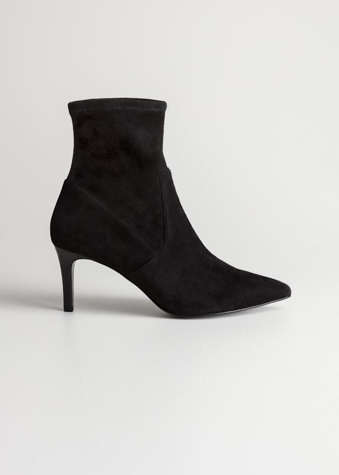 "$195, & Other Stories. <a href=""https://www.stories.com/en_usd/shoes/boots/sockboots/product.suede-sock-boots-black.0527862001.html"">Get it now!</a>"