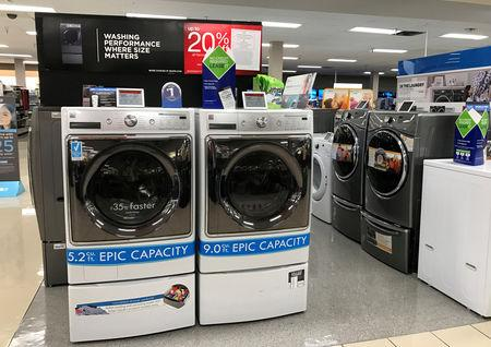 Sears Kenmore washing machines are shown for sale