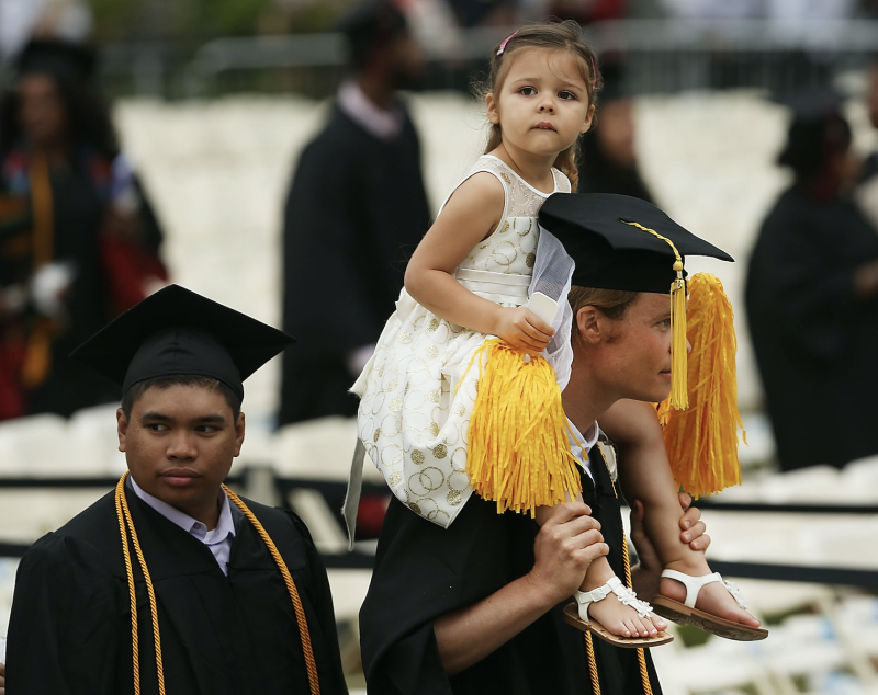Graduating student Kaspar Wittlinger holds his daughter Isabela during ceremonies for commencement exercises at City College on June 3, 2016 in New York City. (Photo: Spencer Platt/Getty Images)