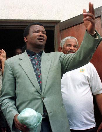FILE PHOTO: United Democratic Movement (UDM) leader Bantu Holomisa addresses a meeting in Nyanga township near Cape Town, South Africa March 10, 1999. REUTERS/Mike Hutchings/File Photo