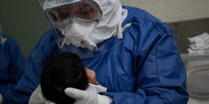 A doctor holds the newborn son of a coronavirus patient at Monica Pretelini Maternal Hospital in Toluca, Mexico, on May 29, 2020. Not the case mentioned in this story.