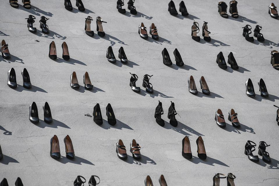 This picture taken on September 17, 2019 in Istanbul shows a contemporary art installation by Turkish artist Vahit Tuna in an attempt to raise awareness on women killed by domestic violence by their partners and husbands. - Turkish artist Vahiot Tuna placed 440 pair of female shoes on the walls of a building to symbolize women killed by their partners and husbands in 2018 in Turkey. (Photo by Ozan KOSE / AFP) / RESTRICTED TO EDITORIAL USE - MANDATORY MENTION OF THE ARTIST UPON PUBLICATION - TO ILLUSTRATE THE EVENT AS SPECIFIED IN THE CAPTION        (Photo credit should read OZAN KOSE/AFP/Getty Images)
