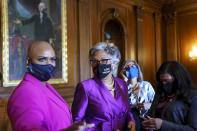 Rep. Ayanna Pressley, D-Mass., left, and Rep. Joyce Beatty, D-Ohio, wait with members of the Congressional Black Caucus for the verdict in the murder trial of former Minneapolis police Officer Derek Chauvin in the death of George Floyd, on Capitol Hill in Washington, Tuesday, April 20, 2021. (AP Photo/J. Scott Applewhite)