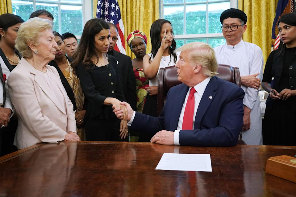 WASHINGTON, DC - JULY 17: U.S. President Donald Trump shakes hands with Iraqi Yazidi human rights activist and Nobel Peace Prize winner Nadia Murad of Iraq while he hosts her and other survivors of religious persecution from 17 countries around the world in the Oval Office at the White House July 17, 2019 in Washington, DC. The survivors are in Washington to attend a State Department conference on religious freedom. (Photo by Chip Somodevilla/Getty Images)