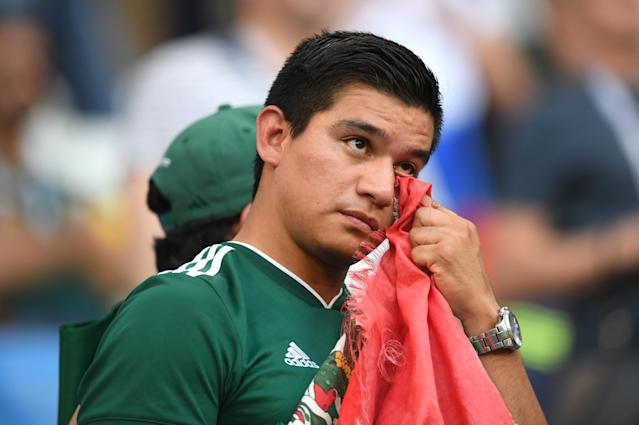<p>A Mexico fan looks dejected following his sides defeat in the 2018 FIFA World Cup Russia Round of 16 match between Brazil and Mexico at Samara Arena on July 2, 2018 in Samara, Russia. (Photo by Matthias Hangst/Getty Images) </p>