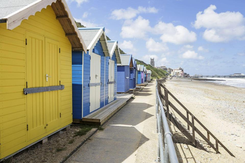 """<p>Bucket-and-spade staycations don't get much better than at Norfolk's beaches. While we're at home social distancing, now is the perfect time to start planning a UK seaside getaway for 2021 – and Norfolk has it all.</p><p>The North Norfolk coast has six Blue Flag beaches at Cromer, Sheringham, West and East Runton, Mundesley, and Sea Palling, ensuring high water quality and cleanliness.</p><p>There's a North Norfolk beach to suit all tastes. If you're looking for raw, unspoilt beauty you'll love the sweeping golden sands backed by dunes and pine trees at Holkham. Or for a traditional British Victorian seaside resort, head to Cromer for its pier and excellent crabbing. Meanwhile, Wells-next-the-Sea offers pastel-hued beach huts and white sand.</p><p>Old Hunstanton and West Runton are excellent for fossil-hunting, while Brancaster is a playground for pooches. Cley Beach and Snettisham are ideal for bird-watchers, and you may even spot seals here or over at Waxham.</p><p>Whether you want to head off on your own to breathe in some restorative sea air, fancy a couple's escape, or a family getaway, everyone is catered for at Norfolk's beaches. You can enjoy picnics, walk on soft sand, soak up the sunsets and take in the magnificent bird-watching opportunities at the salt marshes. There are plenty of gorgeous Norfolk beaches to savour ice cream and fresh crab sandwiches in front of pretty coloured beach huts, too.</p><p>We've picked out 10 top Norfolk beaches for a British summer staycation in 2021 below. </p><p><strong>Covid-19: As with all travel in the UK, please check the <a href=""""https://www.gov.uk/coronavirus"""" rel=""""nofollow noopener"""" target=""""_blank"""" data-ylk=""""slk:latest guidance from the government"""" class=""""link rapid-noclick-resp"""">latest guidance from the government</a> before booking a holiday and travelling.</strong></p>"""