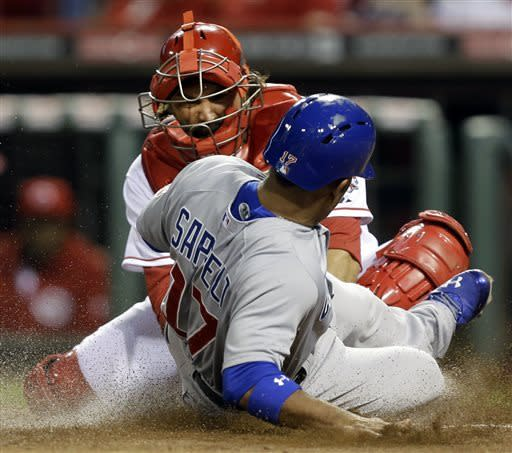 Chicago Cubs' Dave Sappelt (17) is tagged out at home plate by Cincinnati Reds' catcher Corky Miller in the sixth inning of a baseball game, Tuesday, April 23, 2013, in Cincinnati. (AP Photo/Al Behrman)