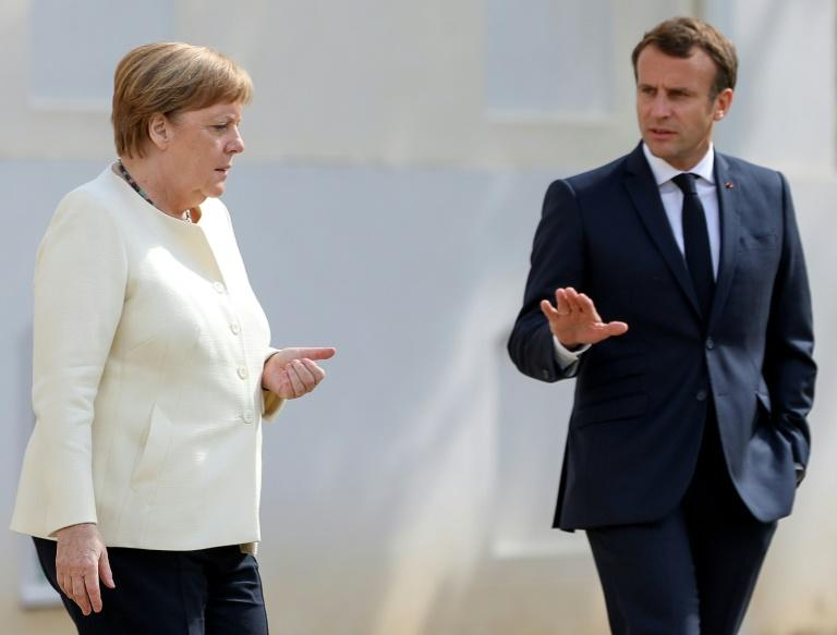 Chancellor Angela Merkel and French President Emmanuel Macron for talks at the German government retreat in Meseberg (AFP Photo/Hayoung JEON)