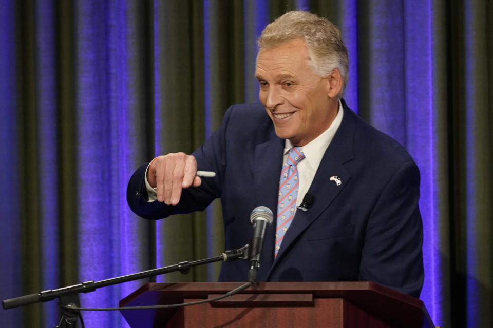 Democratic gubernatorial candidate former Governor Terry McAuliffe, waves to supporters at the start of a debate at the Appalachian School of Law in Grundy, Va., Thursday, Sept. 16, 2021. (AP Photo/Steve Helber)