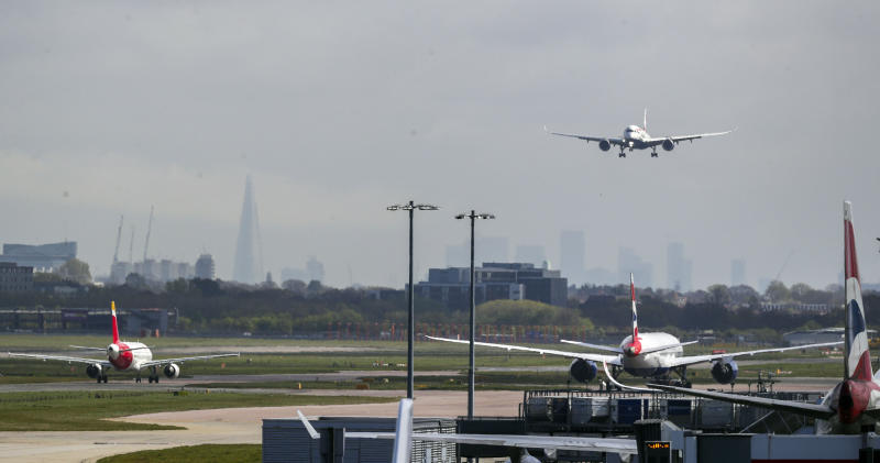A British Airways plane lands on the northern runway at Heathrow Airport. The airport is running only one operational runway as the UK continues in lockdown to help curb the spread of the coronavirus. (Photo by Steve Parsons/PA Images via Getty Images)