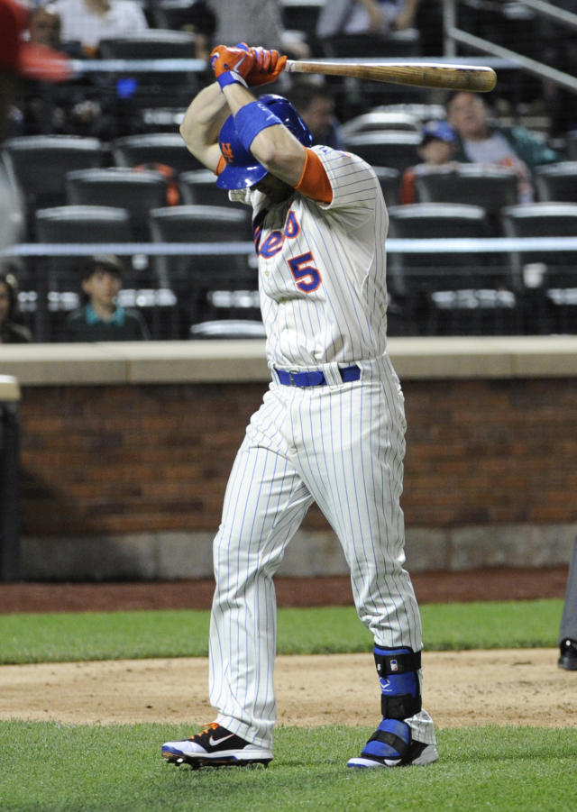 New York Mets' David Wright reacts after hitting a foul pop-up to end the baseball game during the ninth inning against the Philadelphia Phillies, Saturday, May 10, 2014, at Citi Field in New York. The Phillies defeated the Mets 5-4. (AP Photo/Bill Kostroun)