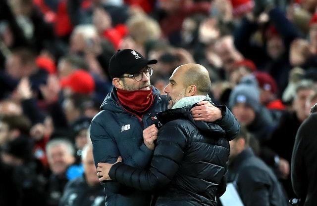 Liverpool took a major step towards a first title in 30 years by beating reigning champions Manchester City 3-1 in November. Jurgen Klopp, left, celebrated victory over Pep Guardiola thanks to goals from Fabinho, Mohamed Salah and Sadio Mane