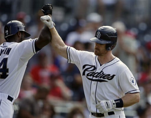 San Diego Padres' Logan Forsythe, right, is greeted by teammate Cameron Maybin after hitting a home run against the St. Louis Cardinals during the second inning of their baseball game on Wednesday, Sept. 12, 2012, in San Diego. (AP Photo/Gregory Bull)