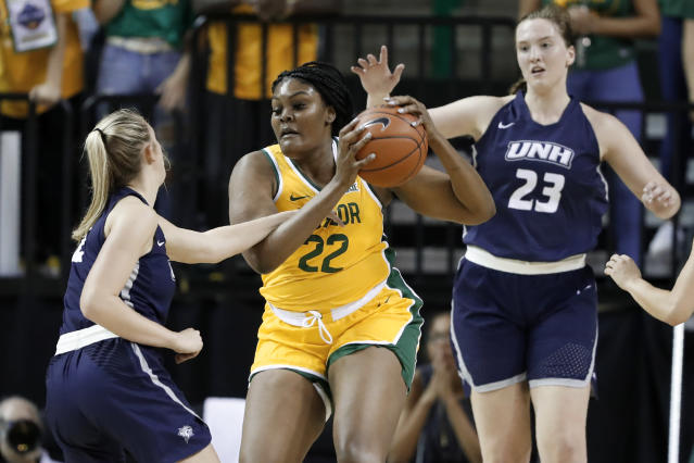 New Hampshire's Brooke Kane (2) and Mary Foster (23) defend as Baylor center Erin DeGrate (22) works to the basket in the first half of an NCAA college basketball game in Waco, Texas, Tuesday, Nov. 5, 2019. (AP Photo/Tony Gutierrez)