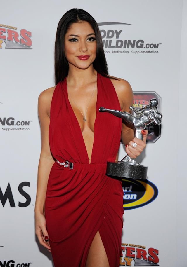 LAS VEGAS, NV - NOVEMBER 30: Ring girl and model Arianny Celeste holds the Ring Girl of the Year award at the Fighters Only World Mixed Martial Arts Awards 2011 at The Pearl concert theater at the Palms Casino Resort November 30, 2011 in Las Vegas, Nevada. (Photo by Ethan Miller/Getty Images)