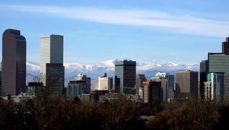 FILE PHOTO: The Continental Divide is seen in the background behind the city skyline in Denver, Colorado