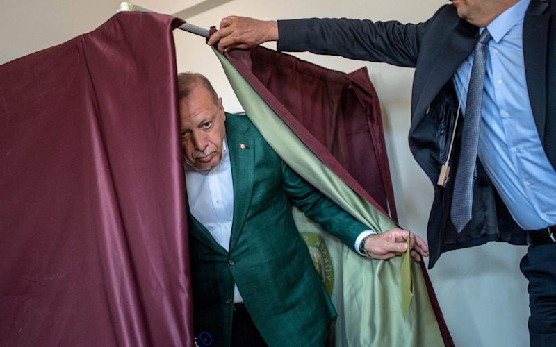 Turkish President Tayyip Erdogan voted in the municipal elections in Istanbul - AFP