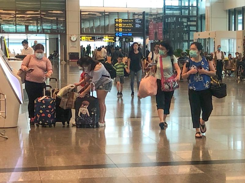 Travellers in face masks at Jewel Changi Airport, amid the global Wuhan coronavirus outbreak in January 2020. PHOTO: Dhany Osman/Yahoo News Singapore