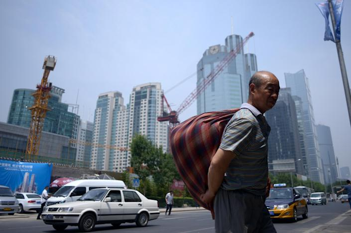 Home prices in major Chinese cities have declined in 10 out of the past 11 months, a survey by the China Index Academy showed last month, raising concerns over the profitability of developers (AFP Photo/Wang Zhao)
