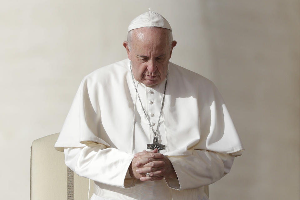 Pope Francis prays during his weekly general audience, in St. Peter's Square, at the Vatican, Wednesday, Nov. 27, 2019. (AP Photo/Andrew Medichini)