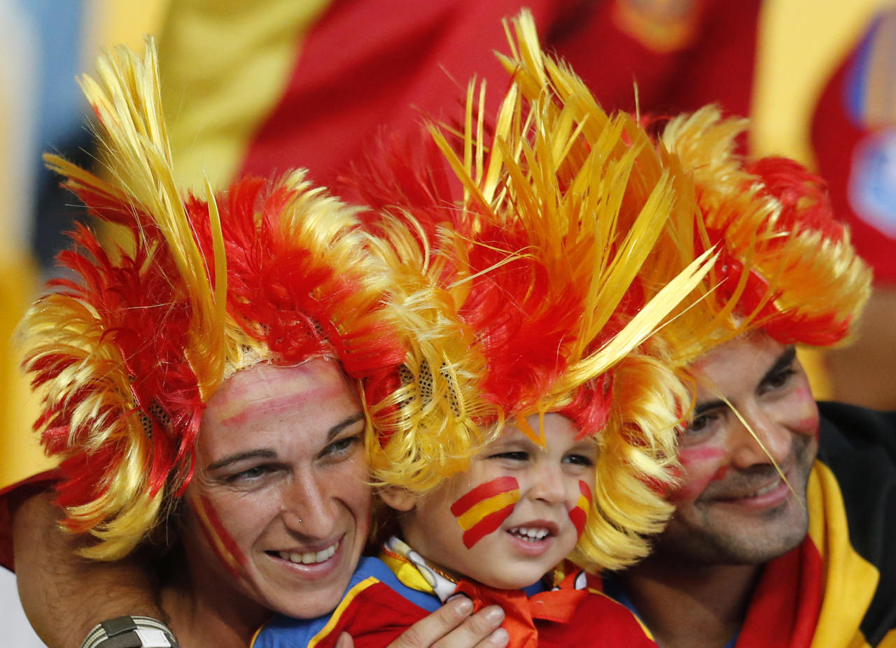 Spanish fans cheer before the Euro 2012 soccer championship final between Spain and Italy in Kiev, Ukraine, Sunday, July 1, 2012. (AP Photo/Matthias Schrader)