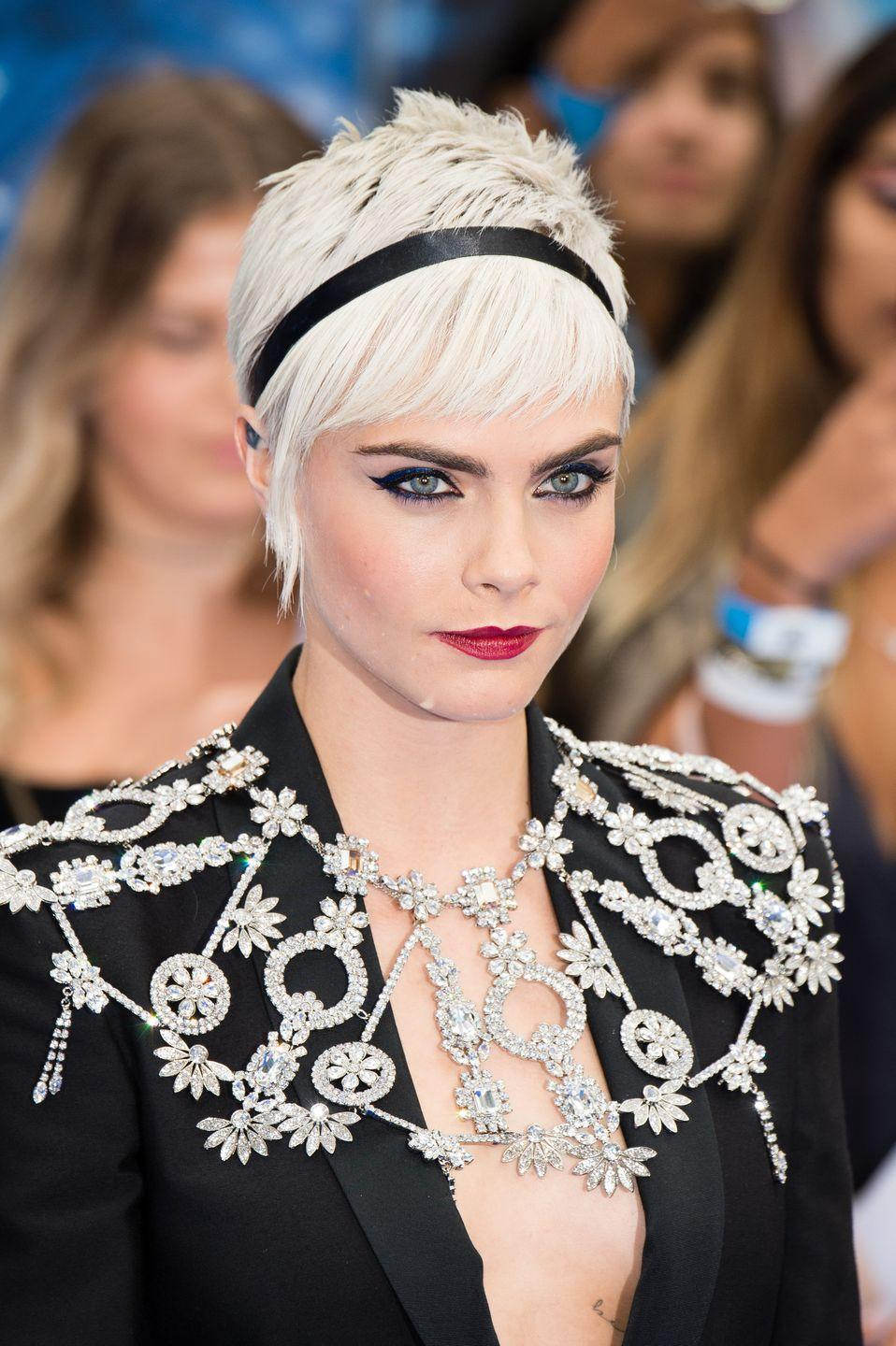 <p>Length at the front gives this pixie on Cara Delevigne a traditionally feminine shape while the platinum shade and short back takes it to a playful, punky place. </p>