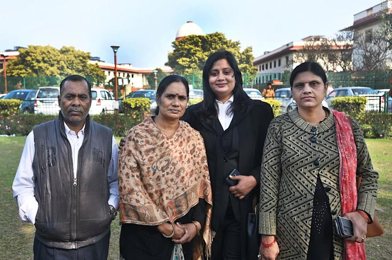 (file photo) Mother of December 2012 gang rape victim, Asha Devi, father Badrinath Singh, and her advocate Seema Kushwaha after Supreme Court rejected the mercy petition of one of the convicts Mukesh Singh, at Supreme Court, on January 29, 2020 in New Delhi.
